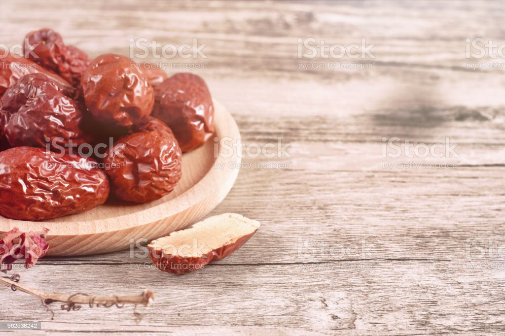 Jujube, Chinese dried red date fruit on wood - Royalty-free Agriculture Stock Photo