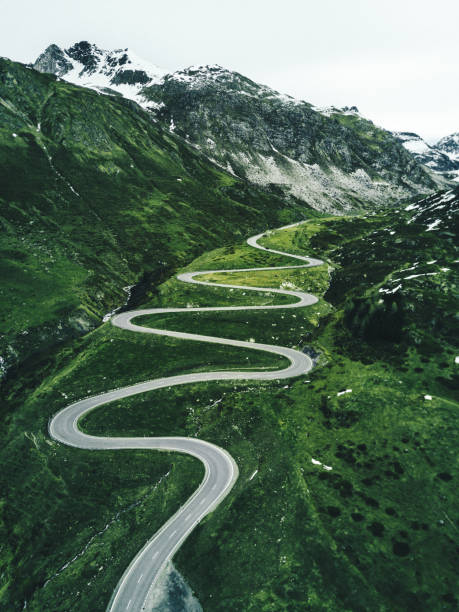 julier pass road in switzerland in autumn julier pass road in switzerland swiss alps stock pictures, royalty-free photos & images