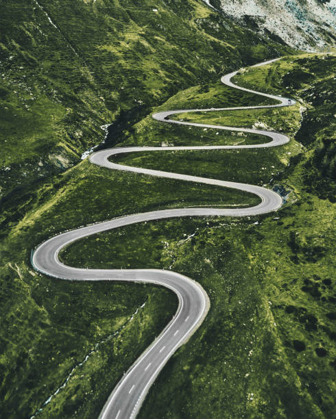julier pass road in switzerland - curve stock pictures, royalty-free photos & images