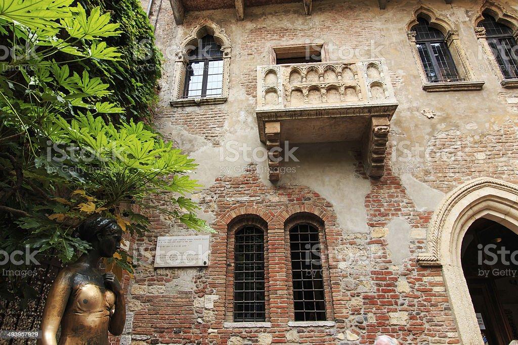 Juliet's balcony and Juliet statue - Verona - Italy stock photo
