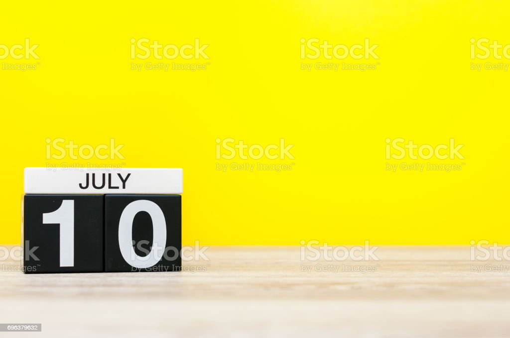 July 10th. Image of july 10, calendar on yellow background. Summer time. With empty space for text stock photo