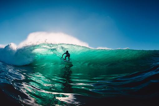 July 12, 2020. Bali, Indonesia. Surfer ride on surfboard at barrel wave. Surfing at Padang Padang