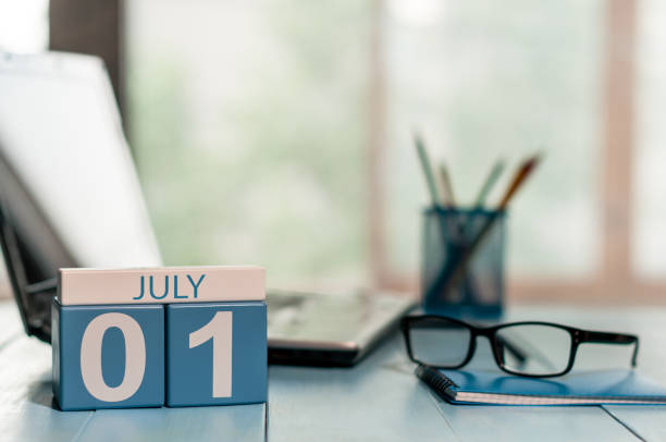 july 1st. day of the month 1 , wooden color calendar on business workplace background. summer concept. empty space for text - july stock photos and pictures