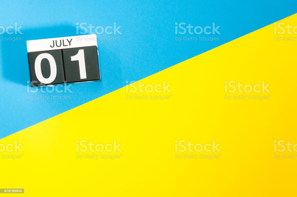 July 1st. Image of july 1, calendar on yellow and blue background with empty space for text. Summer time stock photo