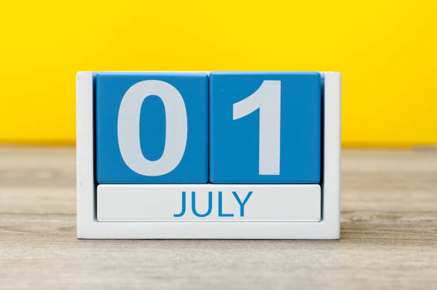 july 1st. image of july 1, close-up wooden color calendar on yellow background. summer day - july stock photos and pictures