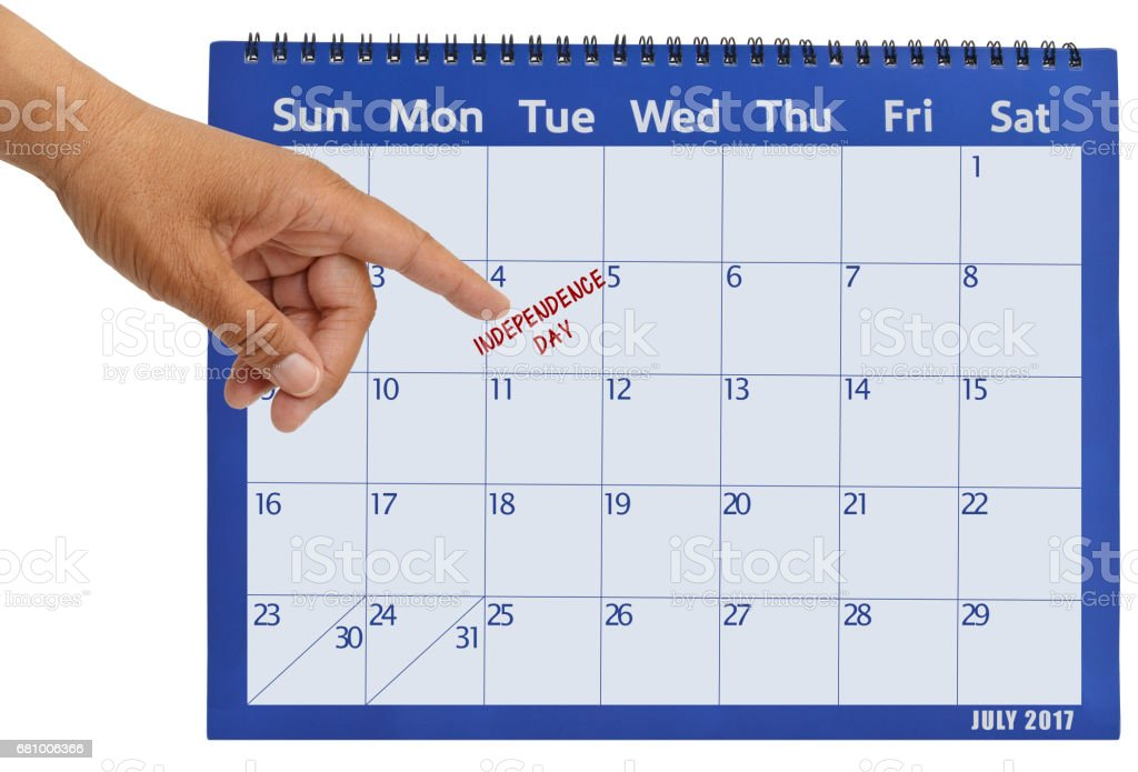 July 2017 Calendar Hand pointing to Independence Day stock photo