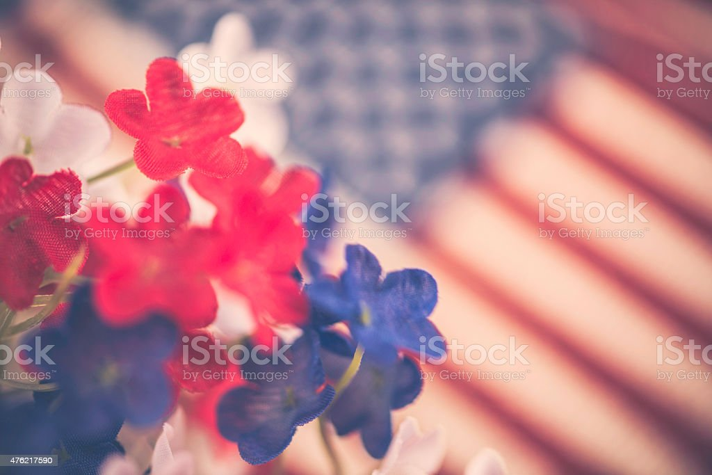 July 4th Background. Patriotic flowers with American flag. Independence Day. stock photo