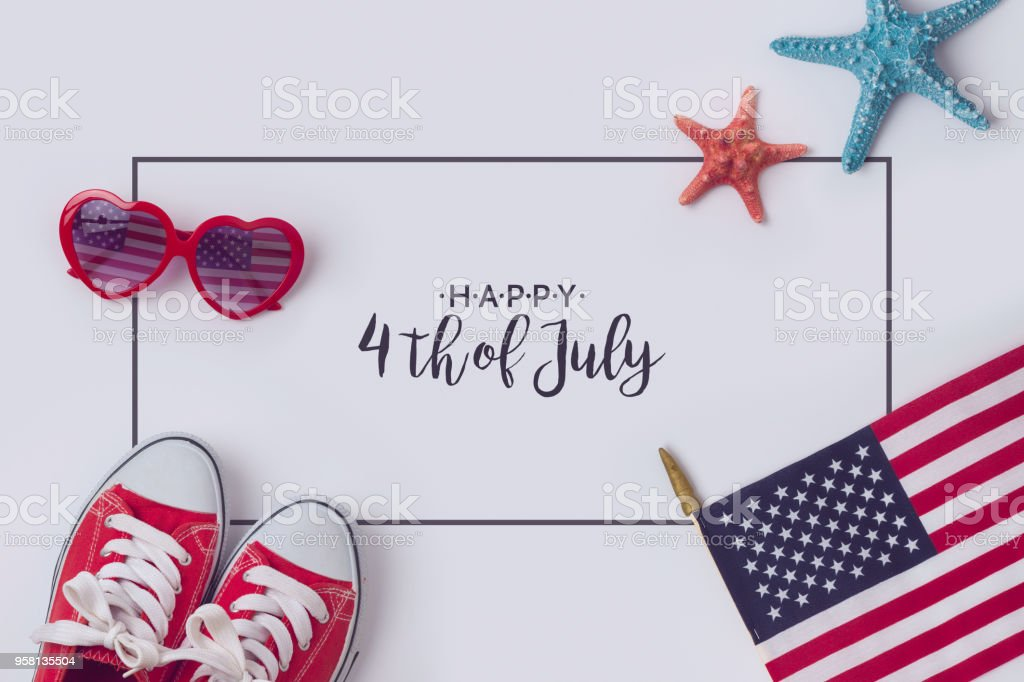 July 4th concept July 4th concept, Independence day celebration with USA flag, sunglasses and sneakers.View from above. Flat lay Fourth of July Stock Photo