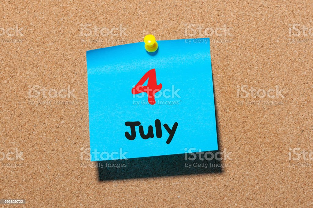 July 4th. Day 4 of month, color sticker calendar on notice board. Summer time. Close up stock photo