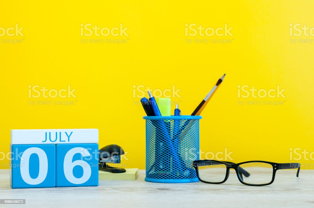 July 6th. Image of july 6, calendar on yellow background with office supplies. Summer time. With empty space for text stock photo