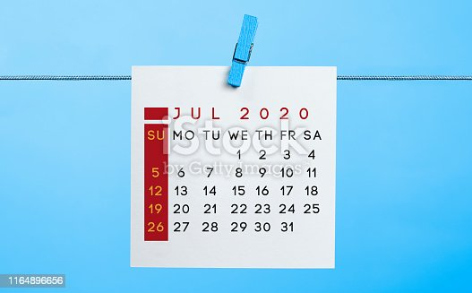 istock 2020 July calendar page hanged on rope with latch 1164896656
