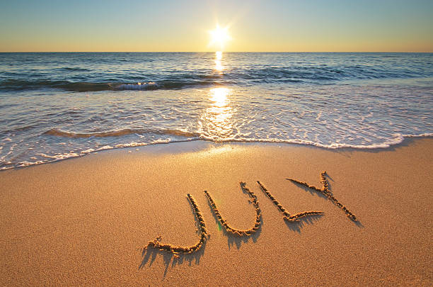 july word on sea - july stock photos and pictures