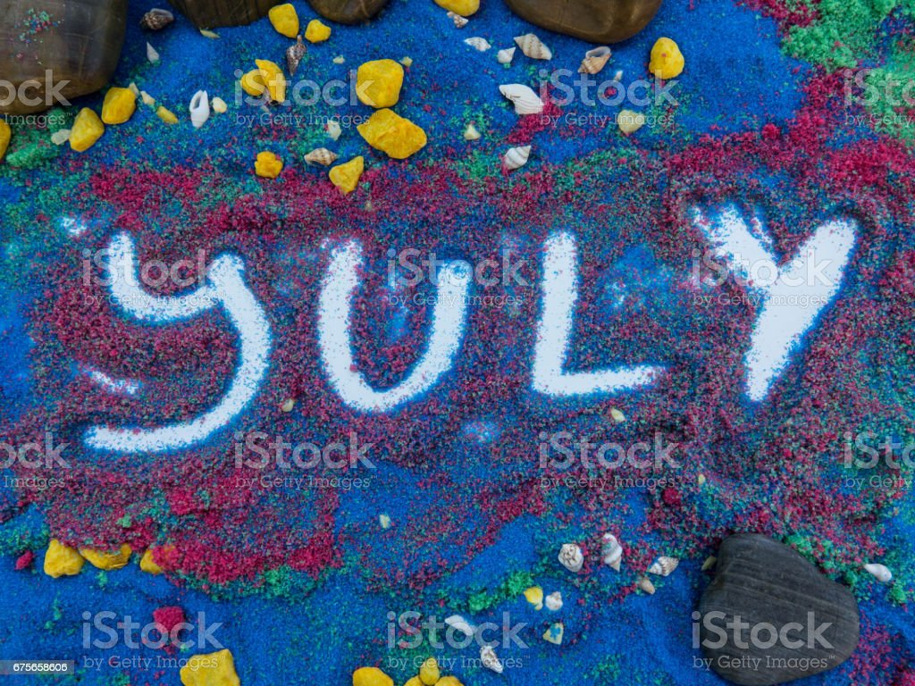july  written  in colors sand royalty-free stock photo