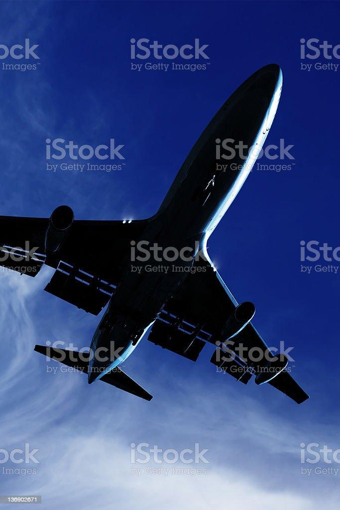 XL jumbo jet airplane landing at twilight royalty-free stock photo