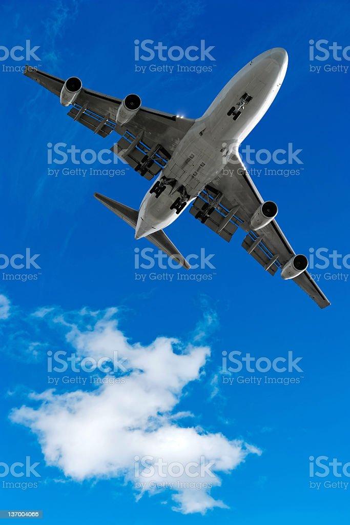 XL jumbo jet airplane landing in bright sky royalty-free stock photo