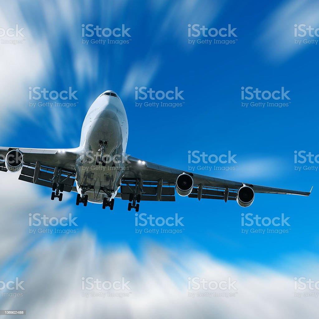 jumbo jet airplane landing in motion blur sky royalty-free stock photo