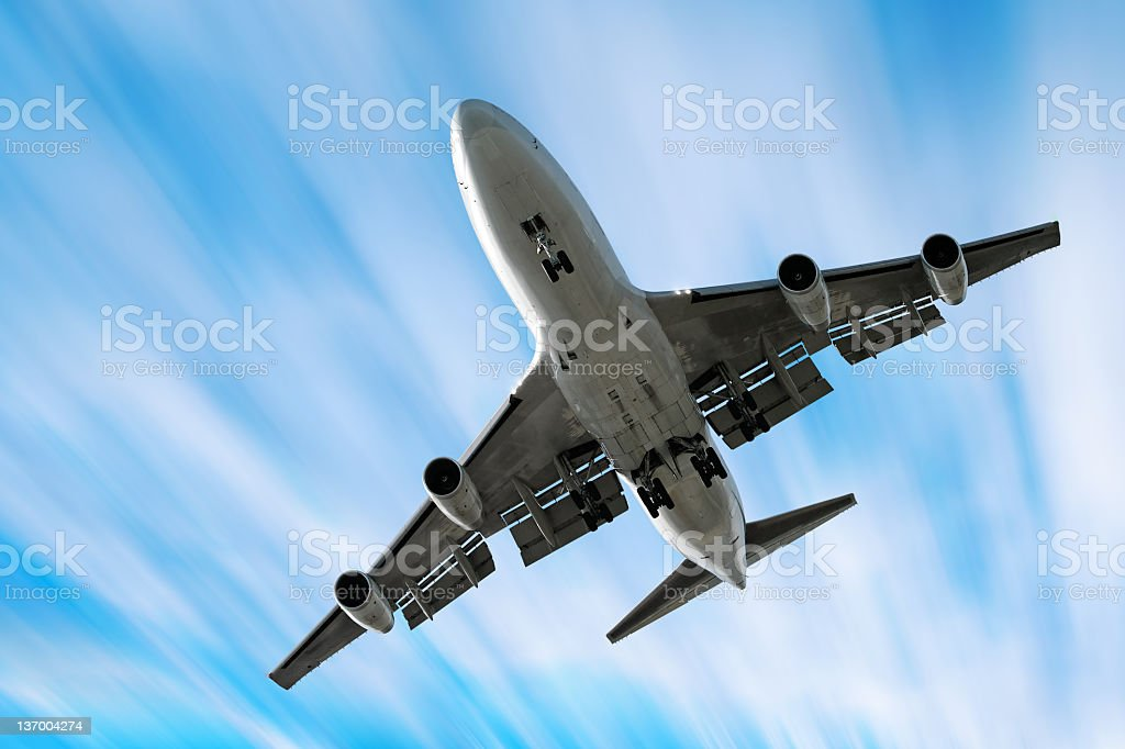XXL jumbo jet airplane landing in motion blur sky royalty-free stock photo