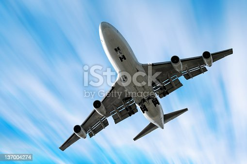 jumbo jet airplane landing in bright motion blur sky (XXL)