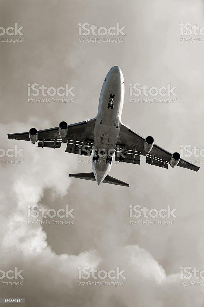 XXL jumbo jet airplane landing in storm royalty-free stock photo