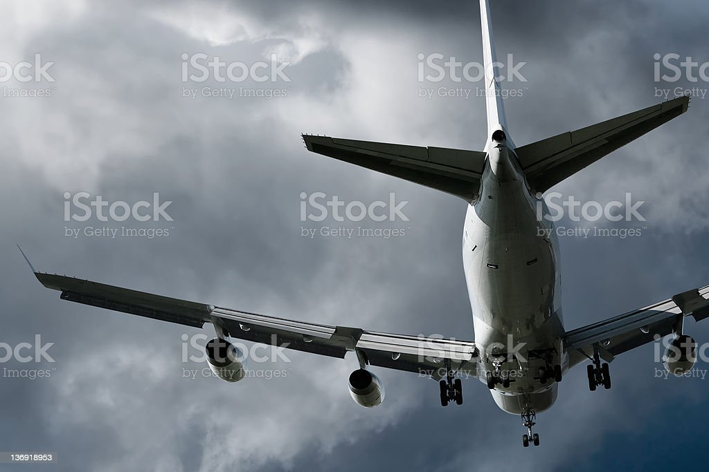 jumbo jet airplane landing in storm royalty-free stock photo