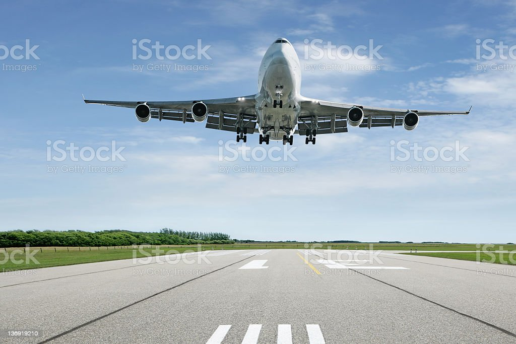 jumbo jet airplane landing stock photo