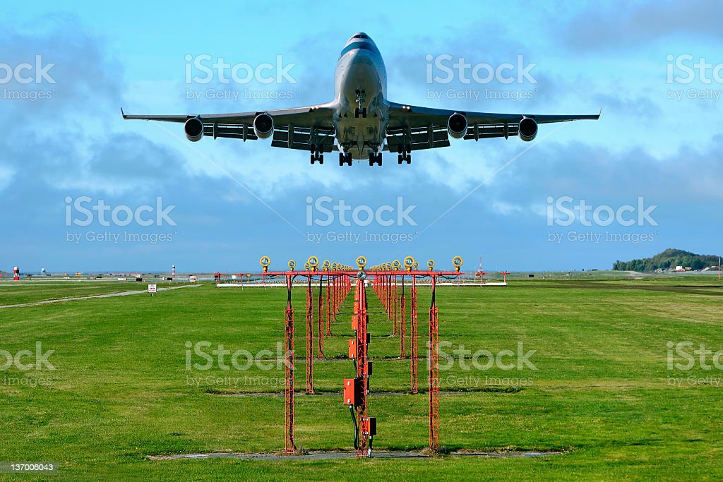 jumbo jet airplane landing royalty-free stock photo