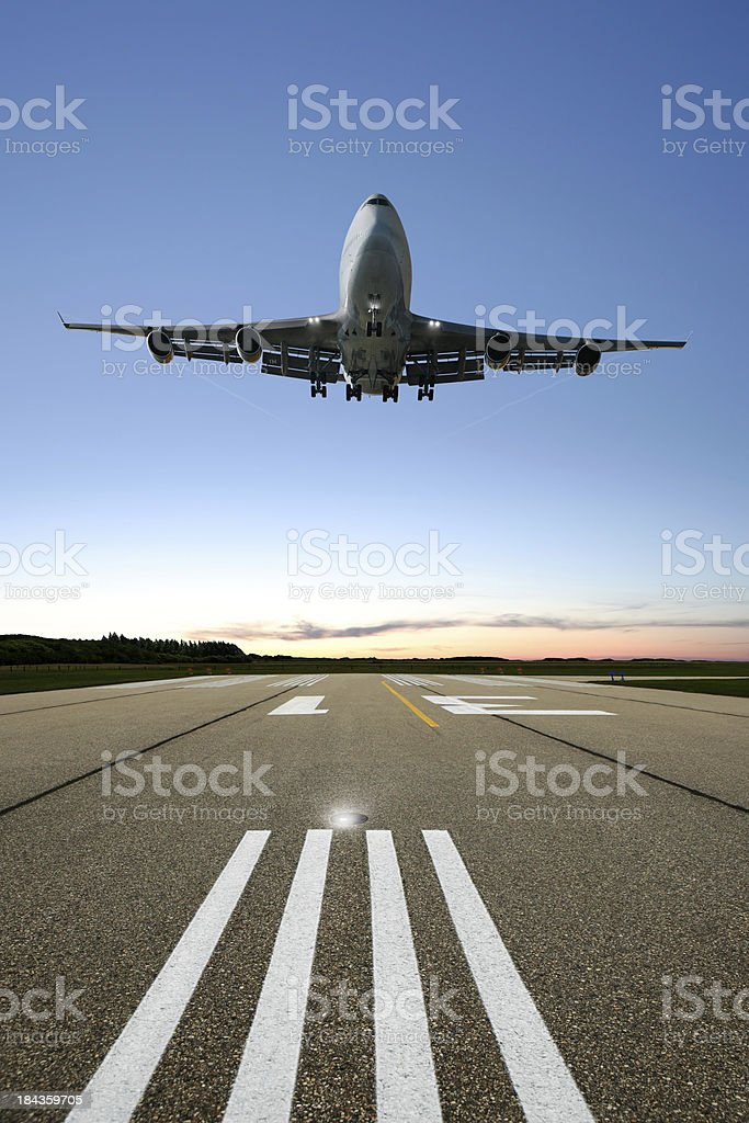 XL jumbo jet airplane landing stock photo
