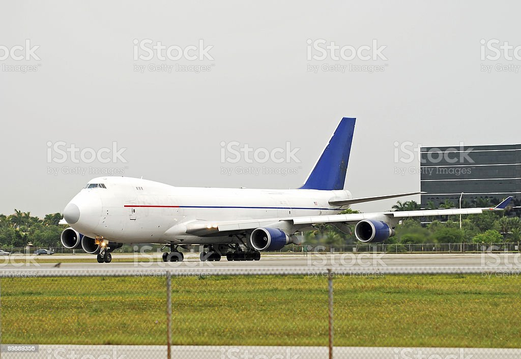 Jumbo jet carrying cargo royalty-free stock photo