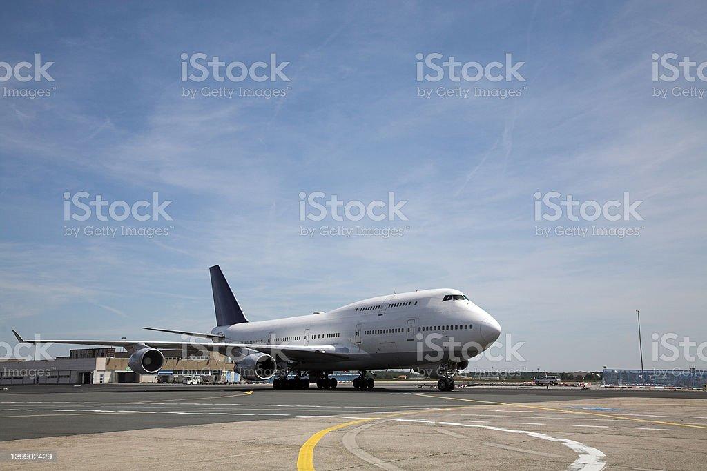 Jumbo Jet on ground stock photo