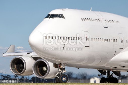 Boeing 747 also known as a jumbo jet lines up on a runway in preparation for takeoff.
