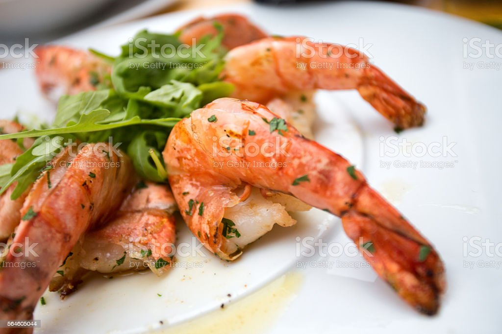 Jumbo Shrimp Displayed With Greens stock photo