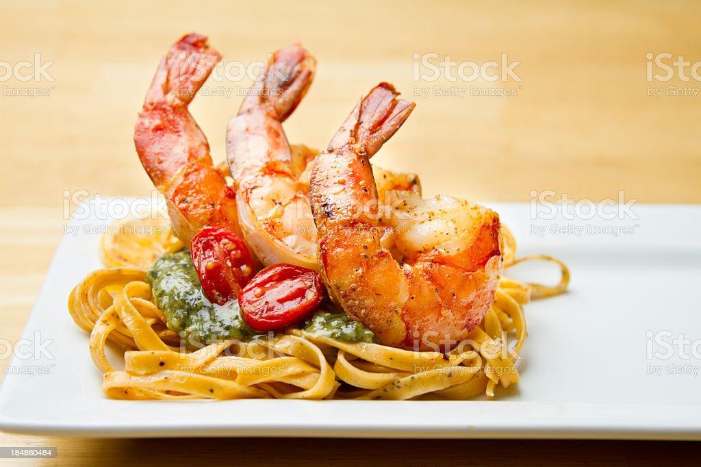 Jumbo Shrimp on bed of Pesto and Pasta royalty-free stock photo