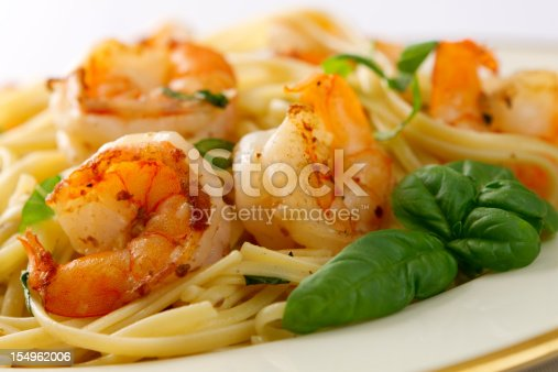 A basil infused version of the classic shrimp scampi served with linguini.