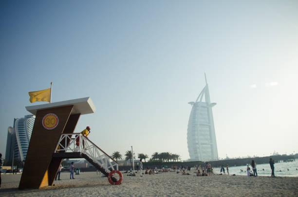 Jumeirah Beach and Burj al Arab Hotel in Dubai stock photo