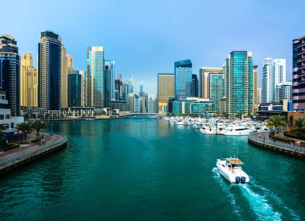 Jumeriah lake towers cityscape with boat stock photo