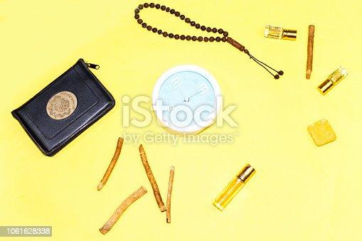 istock jummah mubarak time, holy book of muslims and rosary, siwak, perfume on colorful background 1061628338