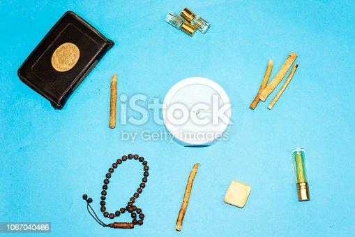 istock jummah mubarak time, holy book of muslims and rosary, siwak, perfume on blue background 1067040466