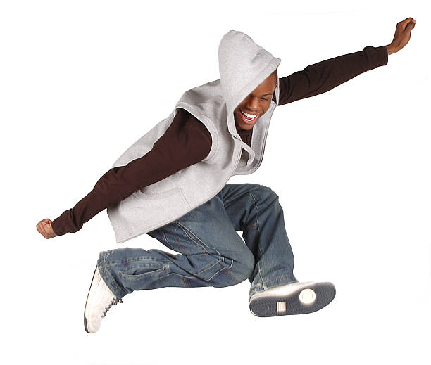 jump for joy! - african youth jumping for joy stock photos and pictures