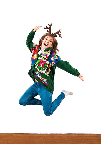 jump for joy - ugly sweater stock photos and pictures