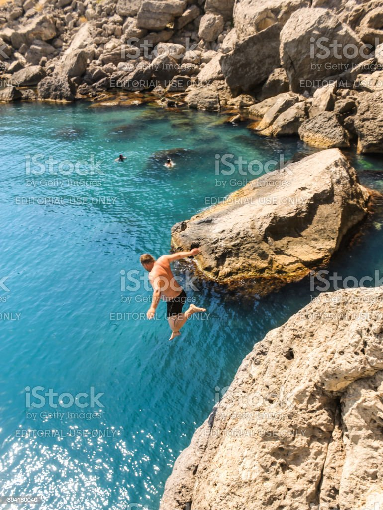 Jump from rock to water. royalty-free stock photo