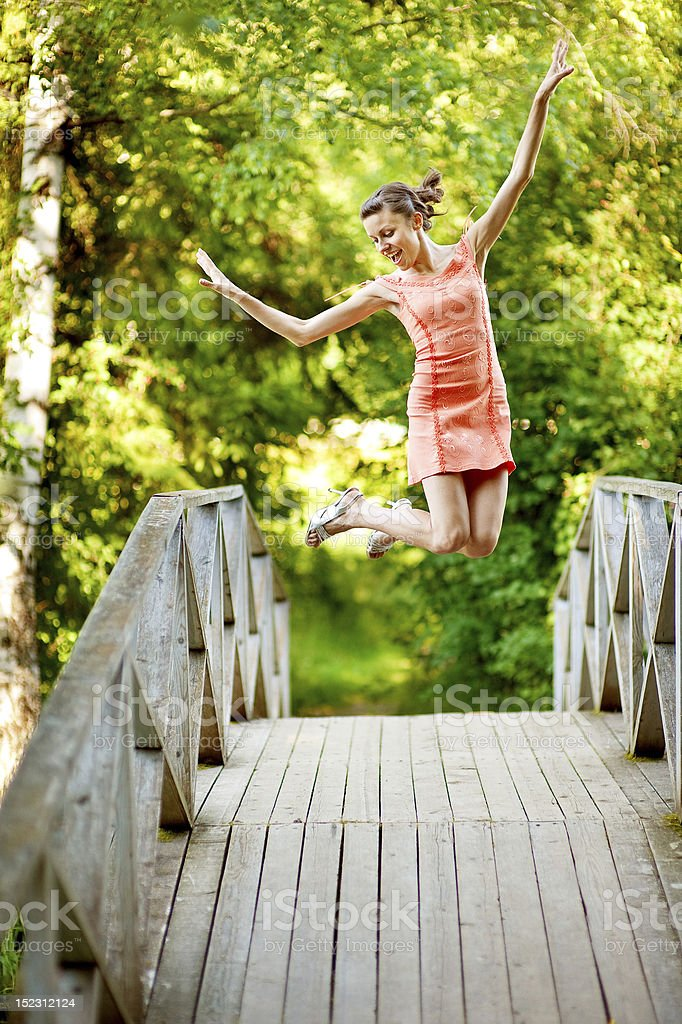 Jump girl on summer bridge royalty-free stock photo