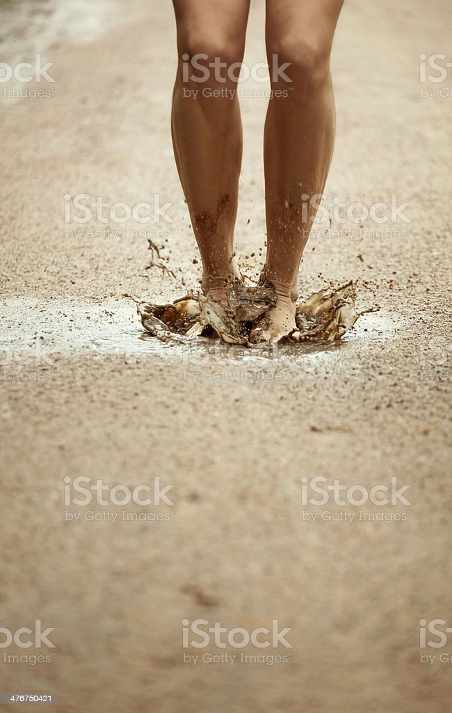 Jump into a muddy puddle stock photo