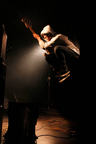 jump on stage - punk music stock photos and pictures