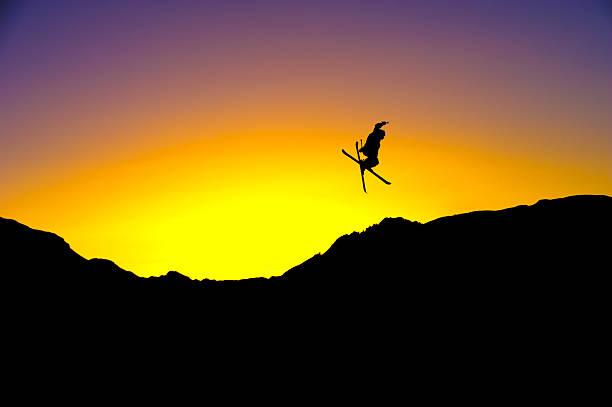 Jump on sunset stock photo