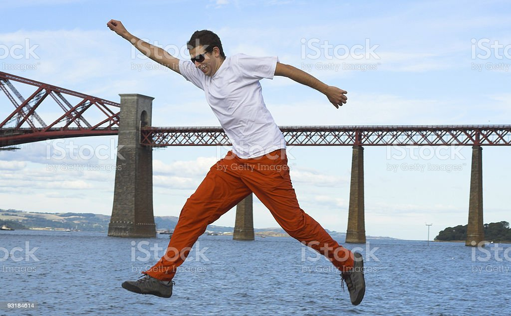 Jump or big step over water with bridge as background royalty-free stock photo