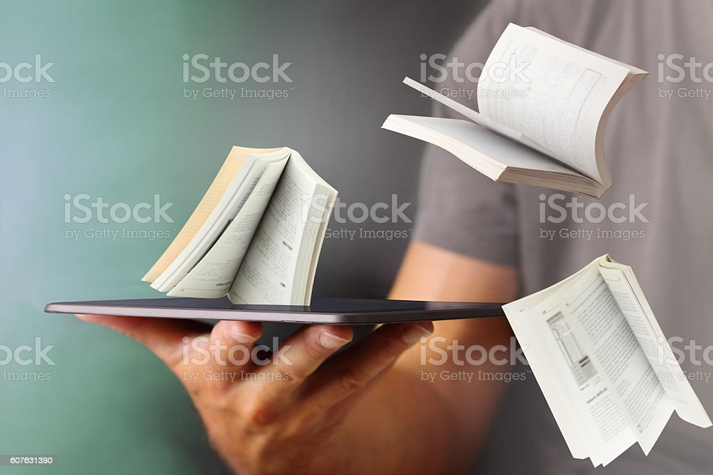 Jump out books from the tablet stock photo