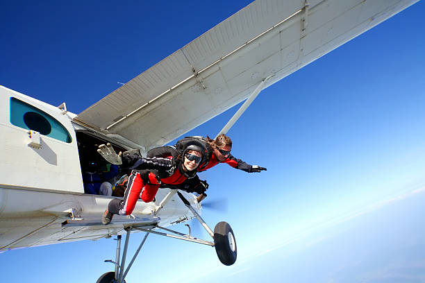 Jump Parachuters jumping from the plane parachuting stock pictures, royalty-free photos & images