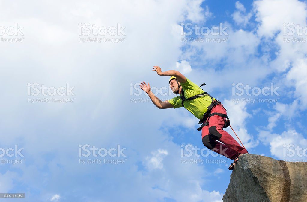 Jump rope from a high rock in the mountains. royalty-free stock photo