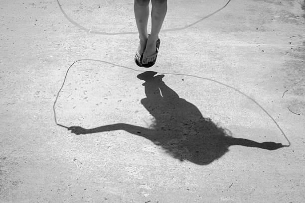 Jump Rope Shadows stock photo