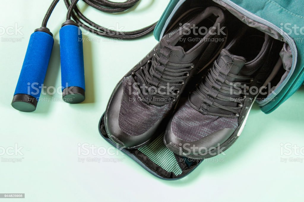 Jump rope, sport shoes and sport bag stock photo